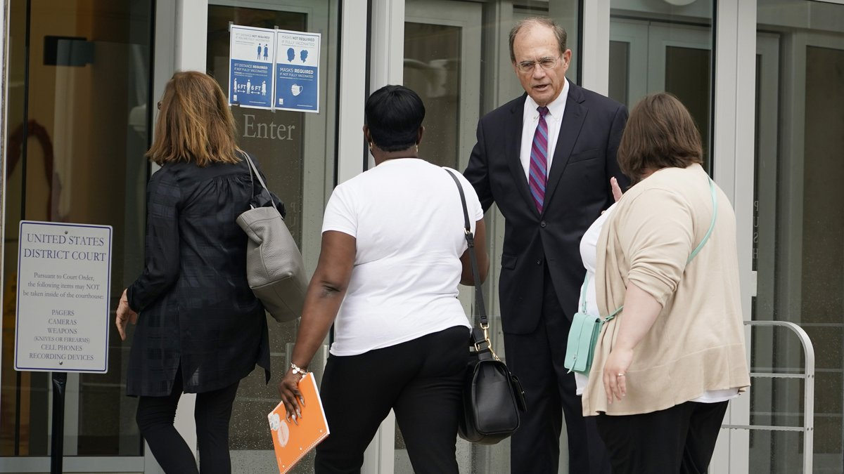 Lt. Gov. Delbert Hosemann, background, greets mental health advocates as they enter the federal...