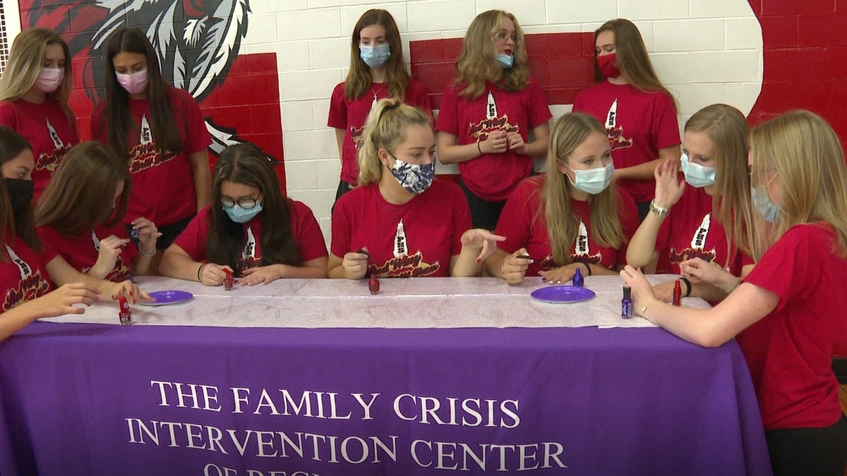 Red Wings paint their nails purple for National Domestic Violence Awareness Month